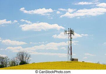 Transmitter - GSM transmitter tower on a rural landscape