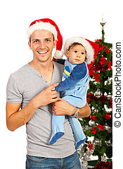 Happy father with baby at Christmas