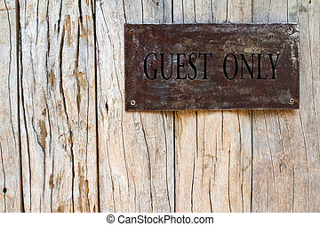Metal nameplate on wooden door