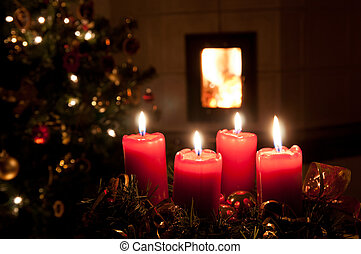 Christmas advent wreath with burning candles. Lights on...