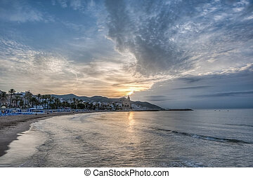 Sunset at Sitges, Spain - Sun sets on Sitges village on...