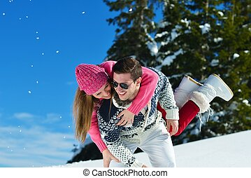 Young Couple In Winter Snow Scene - Young Couple In winter...