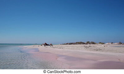 Holiday at the famous pink sand of Elafonisi beach, Crete,...