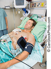 Patient With Holter Monitor Sleeping In Examination Room -...