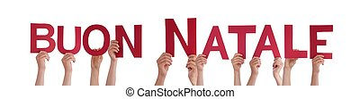 People Holding Buon Natale - Many People Holding the Italian...
