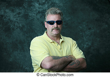 cool dude - a man staning posing in sun glasses
