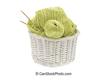basket of knitting and yarn - wicker basket of knitted...