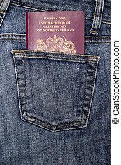 Passport in a pocket - British passport in a denim jeans...