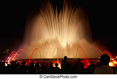 Night view of Magic Fountain light show in Barcelona, Spain