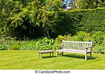 Garden bench  - Wooden bench in a summer garden