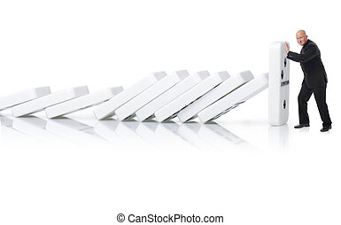 stopping a domino effect - Concept of stopping a domino...