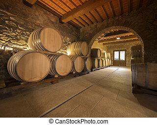 oak wine barrels stacked in winery cellar