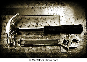 Grunge work tools - Work tools on a grunge metal background