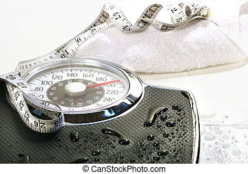 Weight scale and towel on white tile floor