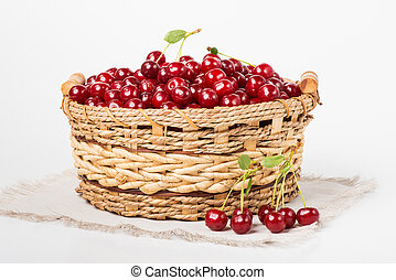 Sweet juicy cherry in basket - Sweet cherry in basket on...
