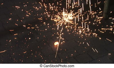 Sparks Falling 2 - Sparks falling and hitting the floor in...
