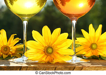 Golden wine in the sun on a rustic table - Golden wine in...