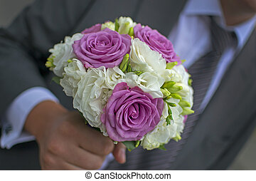 Groom - An elegant hand-tied bouquet or bunch of flowers in...