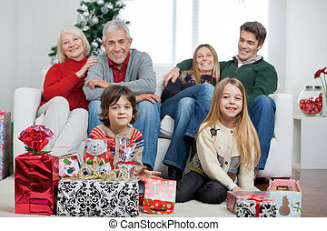 Family With Christmas Gifts In House - Portrait of happy...