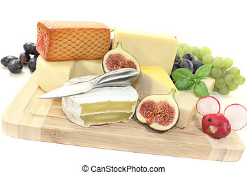 great selection of cheese with knife, grapes and figs
