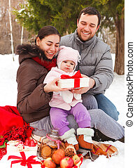 Happy smiling family with at the winter picnic