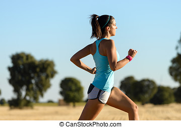 Woman running cross trail - Trail running in country side....
