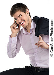 Successful businessman Cheerful young man talking at phone...