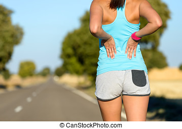 Low back sport injury and pain - Female runner athlete low...