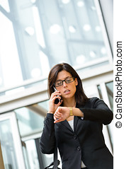 Businesswoman looking time in watch - Stressed Business...