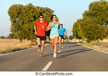 Sport people running in road - Group of sporty people...