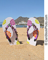 Flip-flops on the Teresitas beach Tenerife island, Canaries...