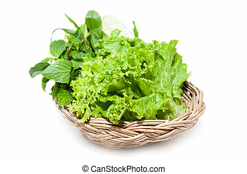 green vegetable in basket on isolated