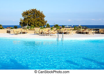 Swimming pool near beach at the luxury hotel, Halkidiki,...