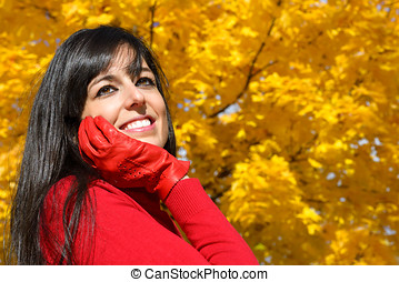 Dreamy woman on autumn in park