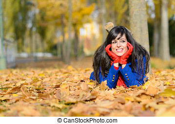 Happy woman thinking in autumn outdoors