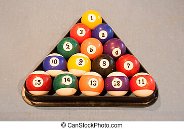 Billiard balls on pool table