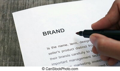 Circling brand  - A person Circling brand with a red marker