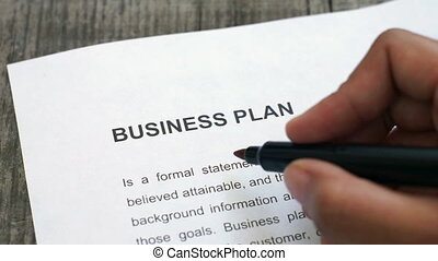 Circling Business Plan - A person Circling Business Plan...