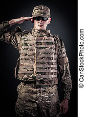 Army soldier saluting. Isolated on a black background