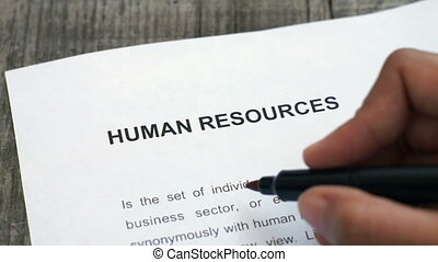 Circling Human Resources - A person Circling Human Resources...