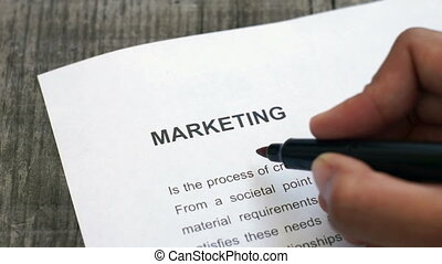 Circling Marketing - A person Circling Marketing with a red...