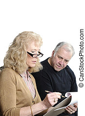 older couple going over thier monthly expenses to determine...