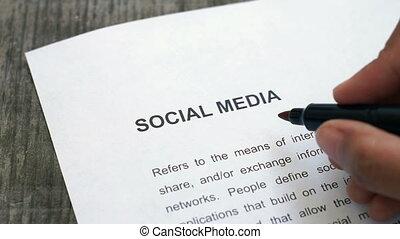 Circling Social Media - A person Circling Social Media with...