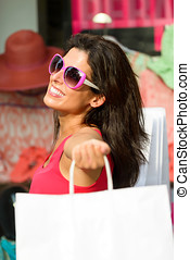 Blissful woman shopping in the sales - Blissful woman...