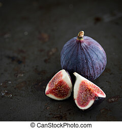 Figs on rustic table in dark tones - Group of figs in a bowl...
