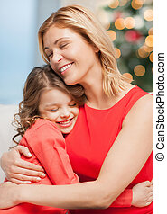 hugging mother and daughter - christmas, x-mas, winter,...