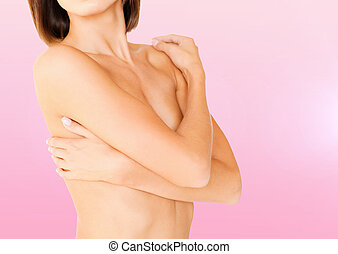 woman with perfect skin and hands over breast