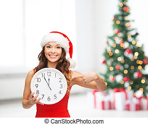 woman in santa helper hat with clock showing 12 - christmas,...