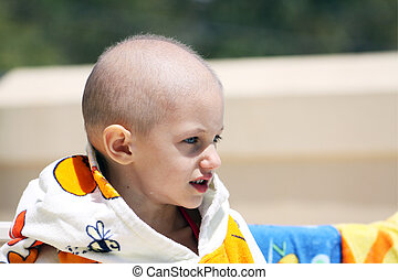 cancer child - a caucasian child cured from cancer just had...
