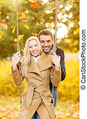 romantic couple in the autumn park - holidays, love, travel,...